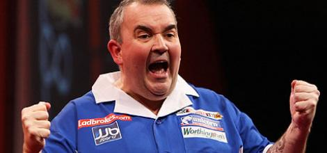 Phil Taylor celebrates victory over Adrian Lewis.